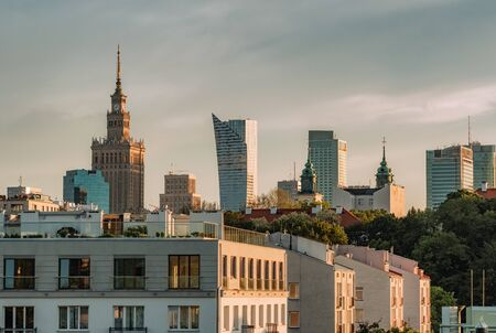 Warsaw skyline with Palace of Culture and Science and modern skyscrapers at sunset