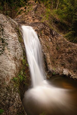 Long exposure shot of a beautiful small waterfall
