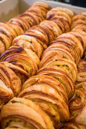 Many freshly backed danish pastries on sale close-up