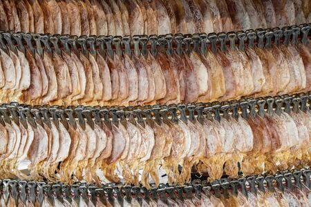 Dried squid, traditional thai drying squids close-up at market stall in Thailand. Seafood background Фото со стока