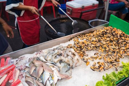 Seafood ingredients for traditional thai omelet at street market stall
