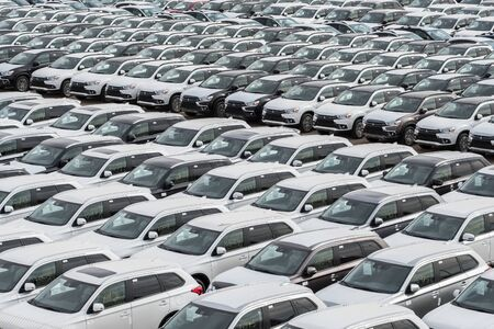 Row of new cars for sale in port