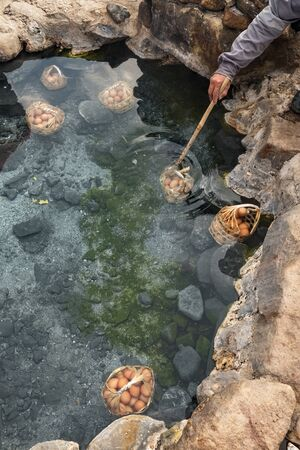Cooking eggs in natural hot spring in Chae Son National Park, Thailand Stock Photo