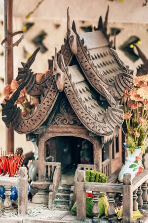 Wooden carved spirit house in Thailand Stock Photo