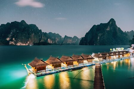 Raft houses on Cheow Lan lake at night in Khao Sok National Park Stock Photo