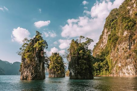 Beautiful limestone cliffs rising from the water on Cheow Lan lake in Khao Sok National Park