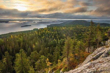 Beautiful nature landscape in Koli national park during ruska season in Finland. Pine forest and lake landscape at sunrise Reklamní fotografie