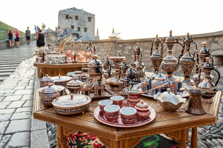 Decorative souvenirs and handicrafts for sale on the Stari Most bridge in Old Town of Mostar BiH