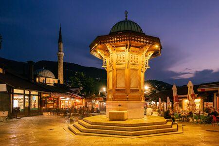 Bascarsija square with Sebilj wooden fountain in Old Town Sarajevo, BiH