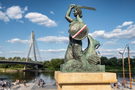 The Warsaw Mermaid called Syrenka on the Vistula River bank in Warszawa
