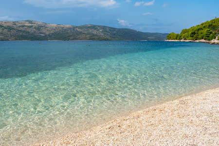 Beautiful empty beach at Adriatic Sea in Makarska Riviera, Croatia Imagens