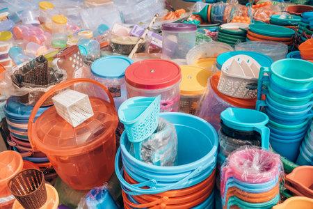 Cheap plastic household items for sale on the market close-up Reklamní fotografie