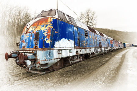 wagons: Old locomotive with wagons standing at a side railroad Stock Photo