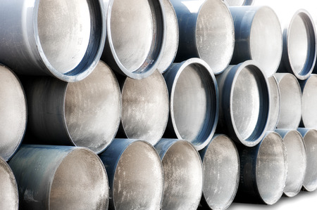 orifice: Industrial Pipes in the Stack Stock Photo
