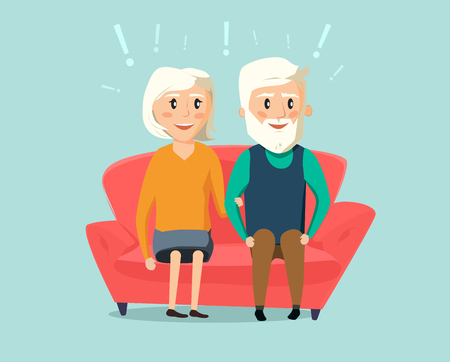Happy old man and woman sitting together on sofa in the room