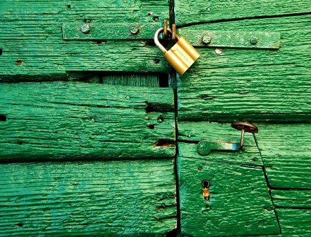 green door with padlock photo