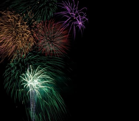guy fawkes night: Bursts of colorful fireworks on dark background, space for copy