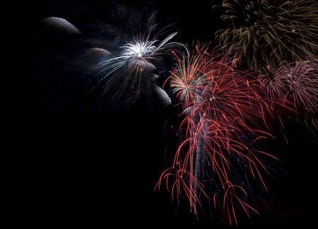Bursts of colorful fireworks on dark background, space for copy photo