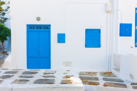 Beautiful blue windows and door frames in Mykonos island cyclades Greece photo