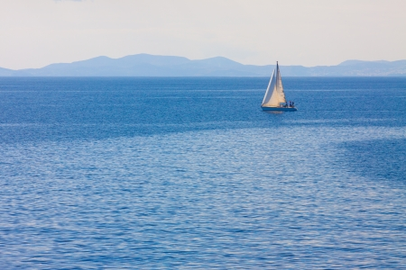 Sailing boat by Mykonos island in cyclades Greece sailing away Stock Photo - 17354638
