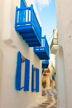 Tiny white path with blue windows in Mykonos Island Cyclades Greece