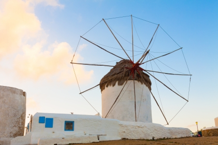 Windmill closeup dawn with partialy blue sky Mykonos island cyclades Greece photo