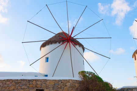 Windmill closeup view with partialy blue sky and clouds in background Mykonos island cyclades Greece photo