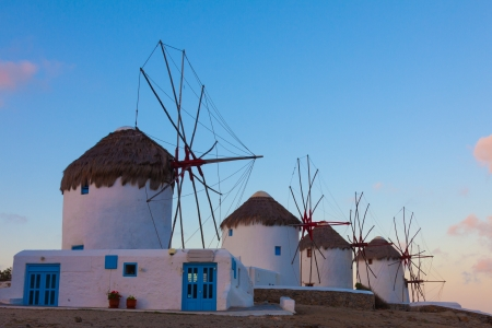 Windmills in a row at dawn Mykonos island cyclades Greece photo
