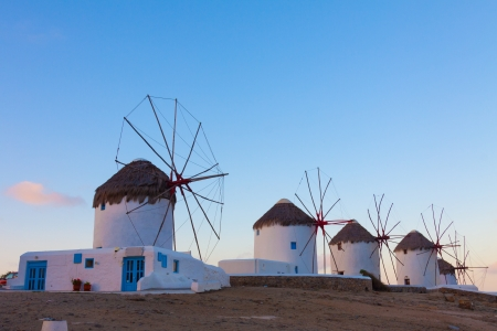 Windmills in a row at dawn with partialy blue sky Mykonos island cyclades Greece Stock Photo - 17352699