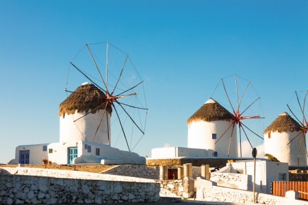 Windmills midrange shoot with blue sky in Mykonos island cyclades Greece photo