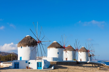 Windmills view in a row with bluew sky in Mykonos island cyclades Greece Stock Photo
