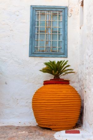 Pot under window frame Greek Island Hydra Saronikos Gulf photo
