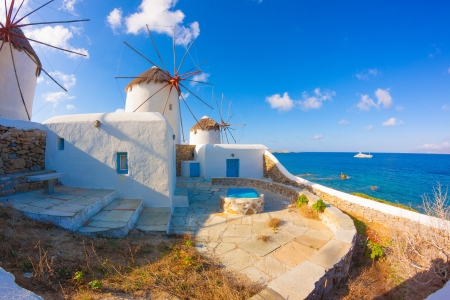 Windmills view with their bases Mykonos island Greece Cyclades Stock Photo