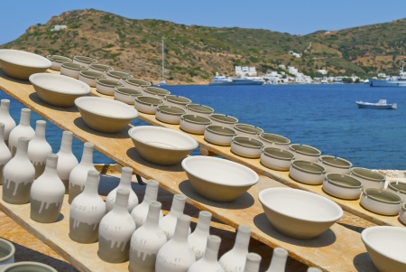 Greece Sifnos,Colorful sea view on the island in front of traditional utensils photo