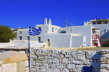 Greek flag waving in Mykonos island Greece cyclades