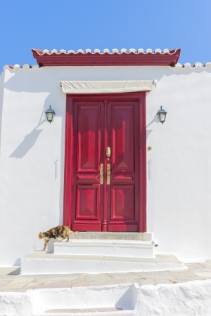 Red wooden door frame in Hydra Island Greece Saronikos Gulf