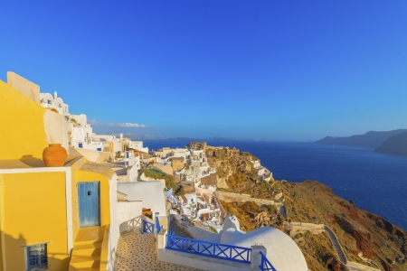 Stunning cupolas with the Caldera (volcano) in the distance in the Greek island of Santorini