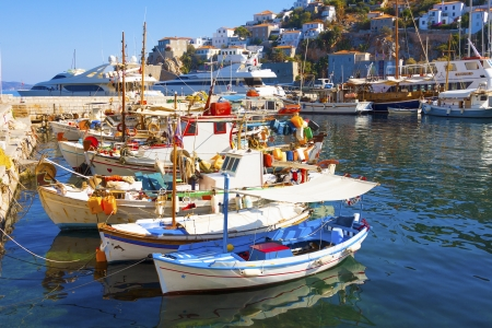 Traditional colorful wooden fishing boats in Greek Island Hydra in Greece Saronikos Gulf