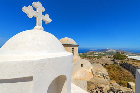 Greece Cyclades Blue and white churches of Oia village photo