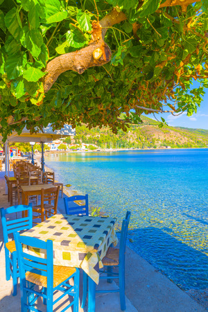 Greece Evoia lake, colorful chairs of a coffee shop by the sea at summer Stock Photo - 25748233
