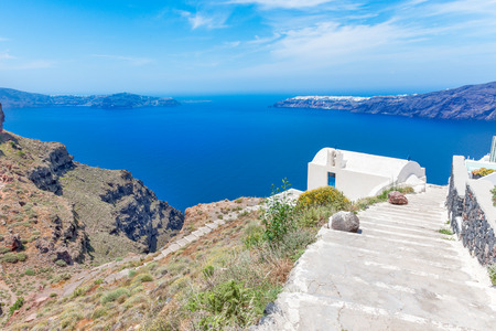 white washed: Greece Santorini island in Cyclades, traditional detail sights of colorful and white washed traditional church and caldera sea in background Stock Photo