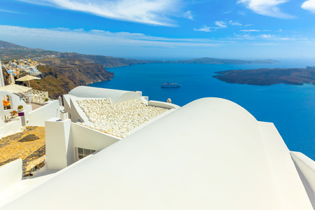 white washed: Greece Santorini island in Cyclades, traditional detail sights of colorful and white washed traditional houses and caldera sea in background