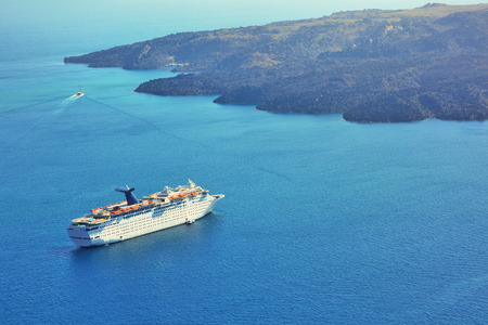 Greece Santorini island in Cyclades, traditional view of caldera with cruise ship