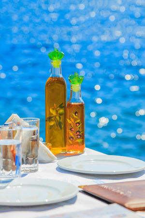 Greece Santorini island in Cyclades, traditional view of greek tavern concept Stock Photo