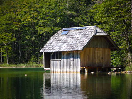 wooden hut: A fishing lodge with Solar array Editorial