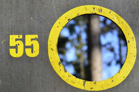 Board with a yellow circle and the number 55 photo