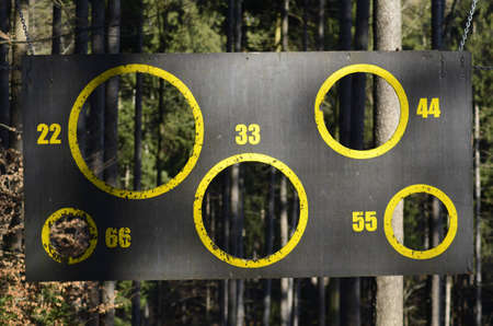 Board with yellow circles and the numbers 22, 33, 44, 55, 66 photo