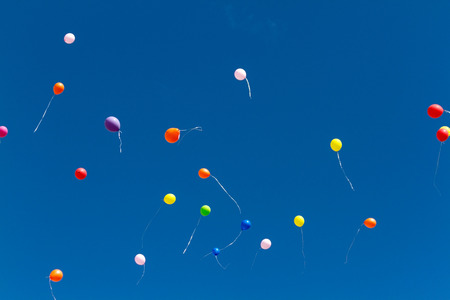 many bright baloons in the blue sky Stock Photo - 66534596