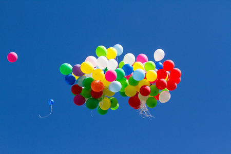 many bright baloons in the blue sky Stock Photo - 66567169