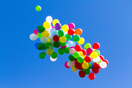many bright baloons in the blue sky Stock Photo - 66533552